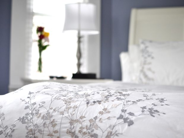 The bed inside the Pleasant Point room has a nice floral embroidery