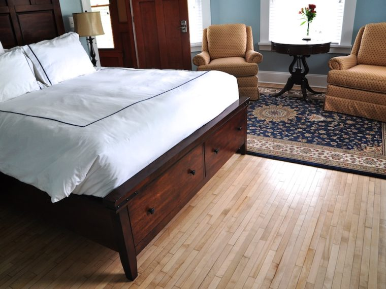The Maplewood room has nice hardwood flooring and a wonderful bed