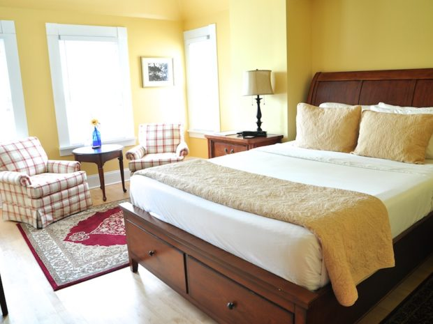 The bed topper matches the yellow walls