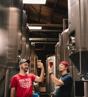 Two brewers sample their craft
