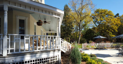 The porch on the outside of the Greenway House leads to a nice open patio